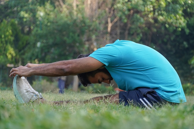 Herbalife24 Products Man Stretching in a Park