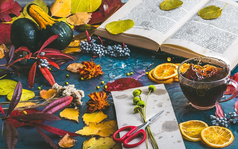 Metabolism Boosting Tea Recipes A Glass of Tea Next to an Open Book with Leaves and Flowers Scattered Around