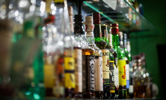 Liquor store pays $97,000 to underpaid migrant workers after probe