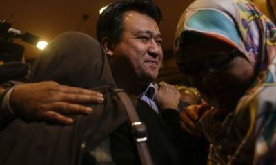 Malaysians held in N'Korea return home