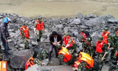 China landslide: More than 90 missing as search continues