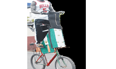 'I put my legs on Danfo buses while riding my unique bicycle'