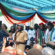 Oshiomole presents APC flag to David Lyon
