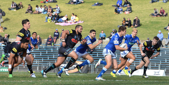Newtown Jets five-eighth and captain Blake Ayshford breaks through the Penrith defensive line at Henson Park on Saturday, with Daniel Abou-Sleiman and Myles Taueli in close support. Photo: Michael Magee Photography