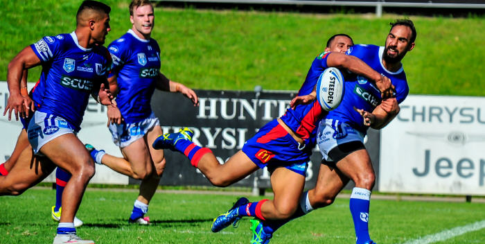Newtown Jets centre Travis Robinson gets his pass away to the fast-supporting half-back Fa'amanu Brown (on the left), with triple try-scorer Jordan Drew (centre) in close attendance. Photo: Gary Sutherland Photography.