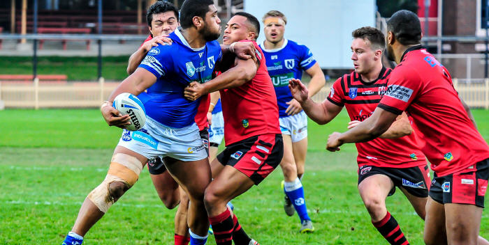 Newtown front-rower Saulala Houma looks to off-load against the North Sydney Bears on Sunday, with Jets team-mate Matt McIlwrick in the background. Photo: Gary Sutherland Photography