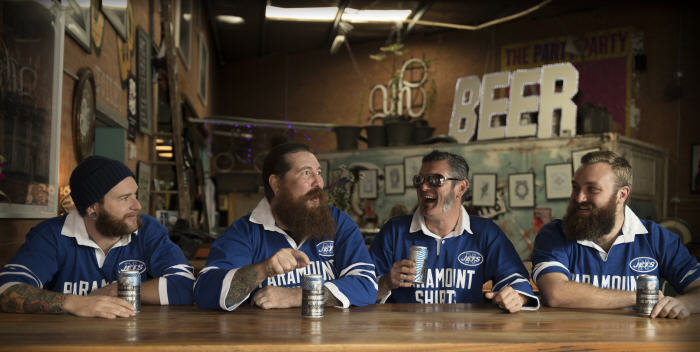 One of the best promotional shots of 2017 – the boys from Young Henrys wearing their Newtown Jets classic jerseys and enjoying a convivial Newtowner Pale Ale. Photo: MAF Photography