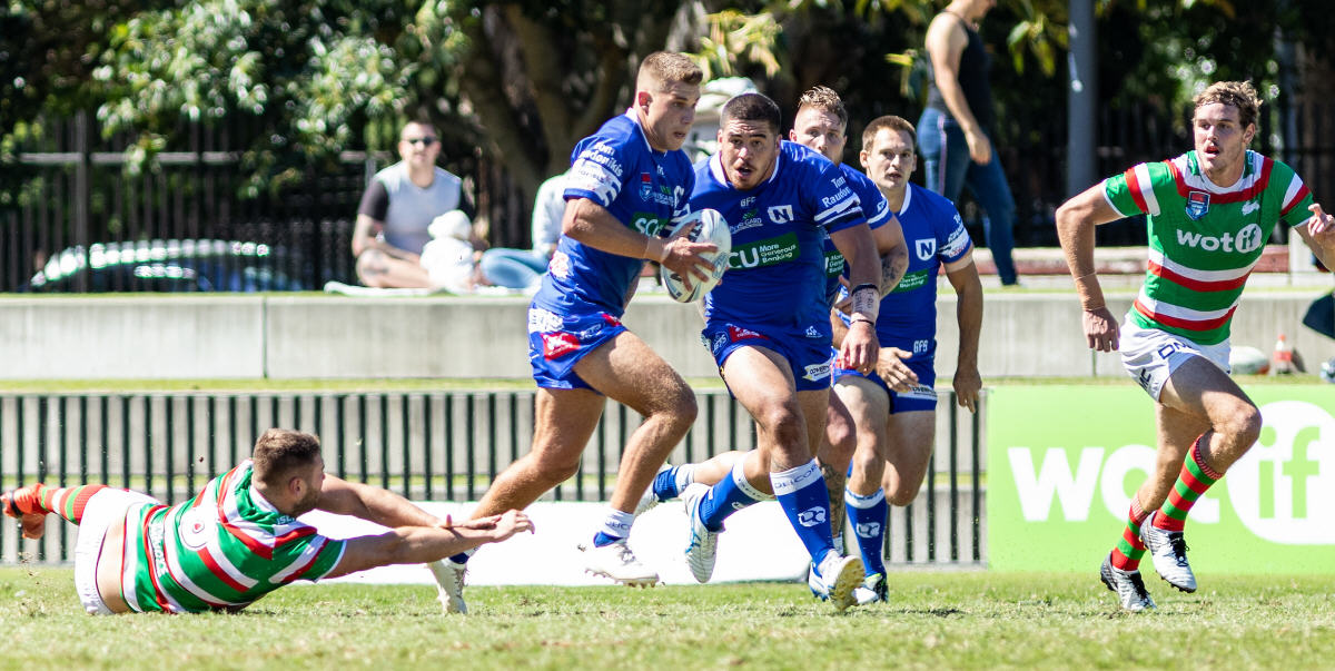 Newtown Jets stand-in five-eighth Luke Polselli makes the break that led to a try by hooker James Segeyaro. Luke's Jets team-mates Braden Hamlin-Uele, Aaron Gray and Matt Evans maintain a keen interest. Photo: Mario Facchini, mafphotography.