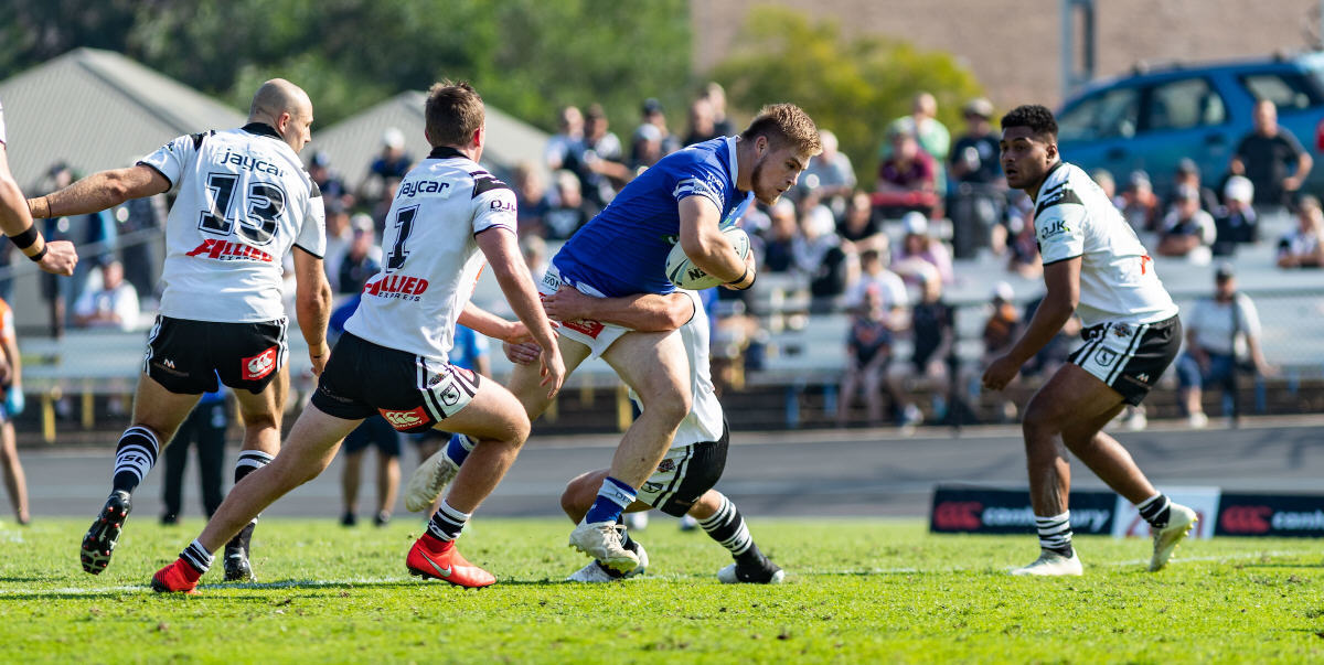Newtown Jets hard-working front-rower Daniel Vasquez takes on the Western Suburbs forwards defence at Lidcombe Oval last Sunday. Photo: Mario Facchini, mafphotography