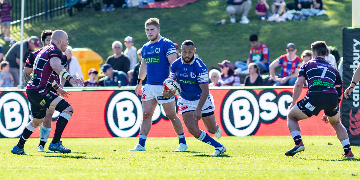 Newtown Jets centre Tyrone Ranuku-Phillips accelerates through a gap in the Blacktown Workers Sea Eagles defence at Lottoland on Saturday. Photo: Mario Facchini, mafphotography