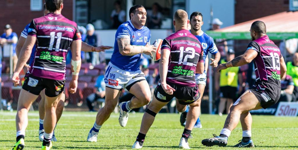 Newtown Jets front-rower Wes Lolo drives hard into the Blacktown Workers Sea Eagles defensive line in last Saturday's Canterbury Cup match played at Lottoland. Photo: Mario Facchini, mafphotography