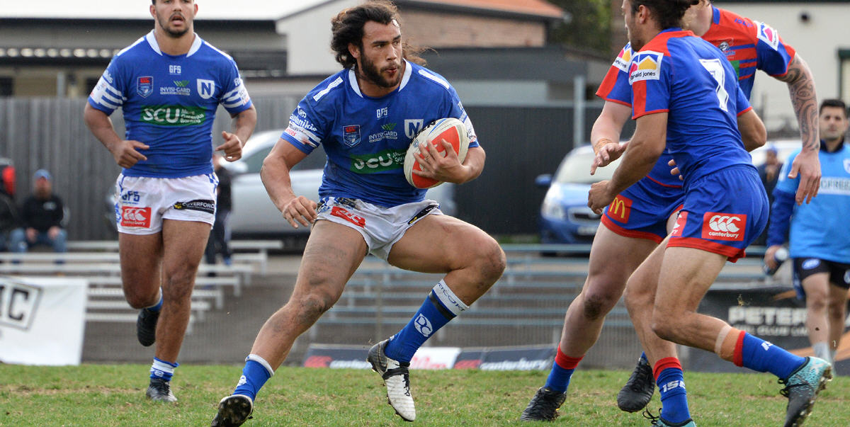 Impressive Newtown Jets back-rower Toby Rudolf looks to wrong-foot the Newcastle Knights defence at Henson Park on Saturday. Photo: Michael Magee Photography.