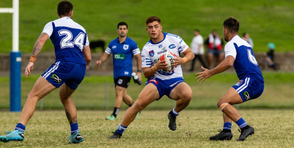 Newtown Jets outside back Jonah Ngaronoa puts a step on two Canterbury-Bankstown Bulldogs opponents at Henson Park on Saturday evening. Photo: Mario Facchini, mafphotography