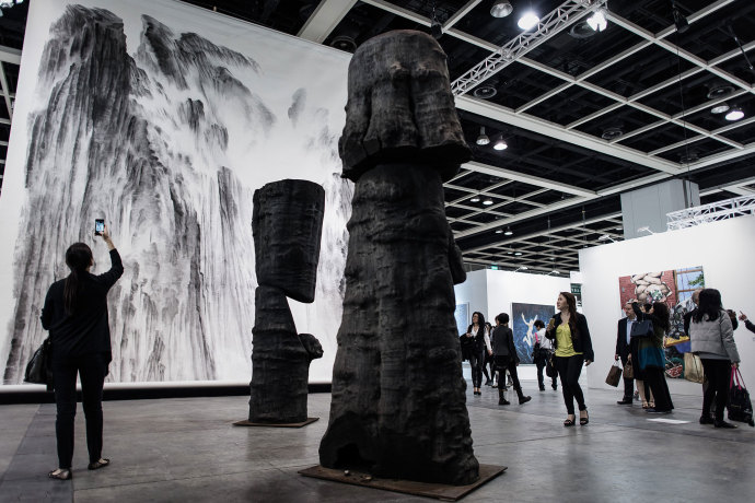 Paintings by Xu Longsen and sculptures by Wang Keping, at Art Basel in Hong Kong.