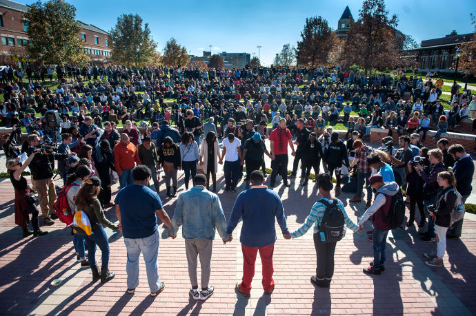 Protesters, students, and media fill Traditions Plaza at the University of Missouri.