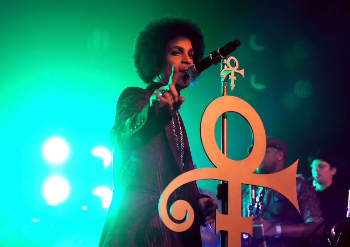 """Prince performs in Los Angeles, in March, 2014. On Friday night, at a club in Manhattan, Prince announced a book that will begin with his first memory and go """"all the way to the Super Bowl"""" of 2007."""
