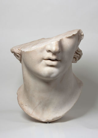 "A fragment of the colossal sculpture ""Head of a Youth"" is among the ancient art works on display at the Met's exhibition of Hellenistic art."