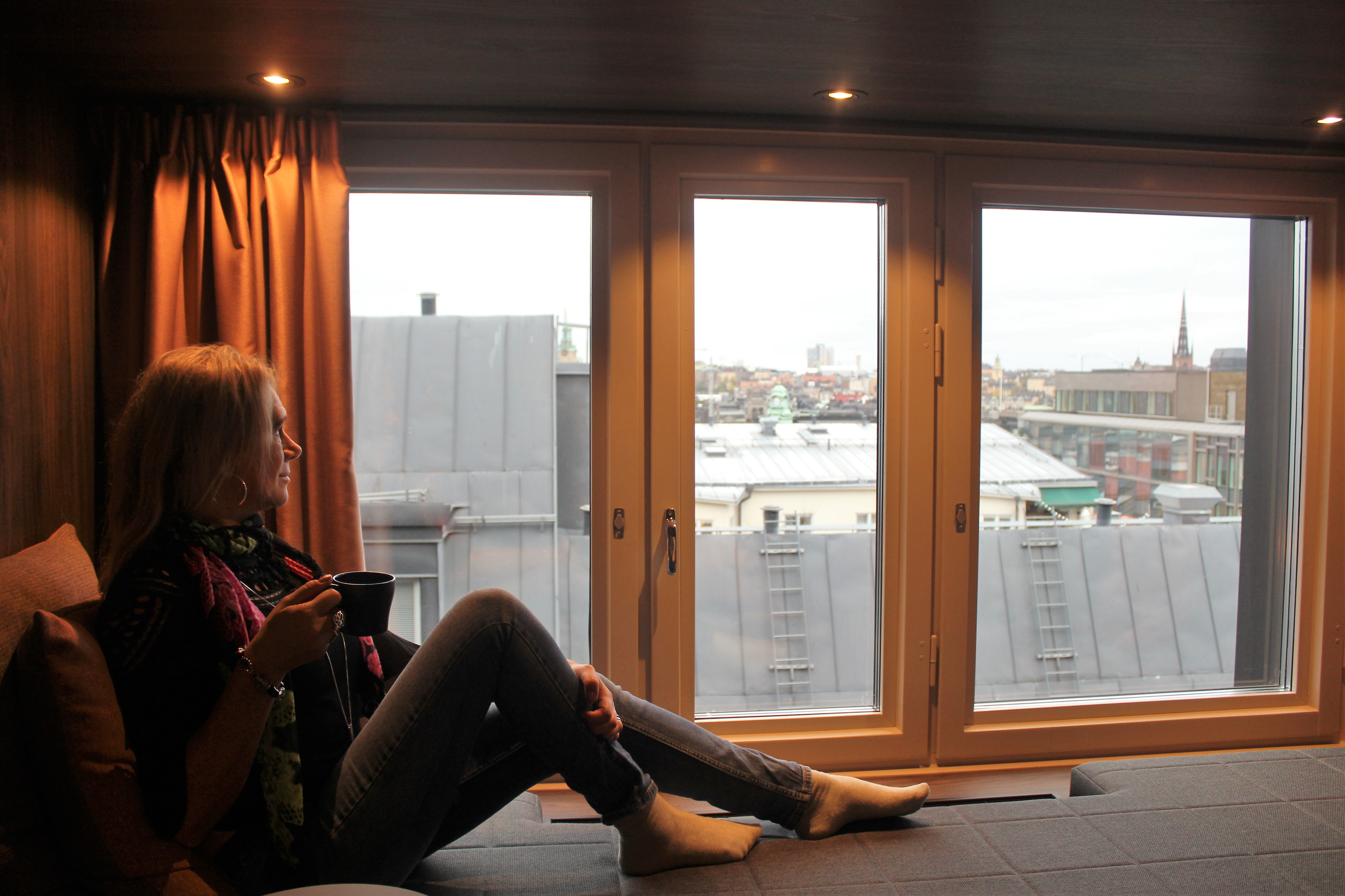 TravelAnna looking out from Downtown Camper by Scandic