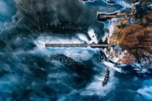 Aerial view of the winter frozen lake with wooden piers captured with a drone in Finland.