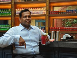Puneet-Gupta-Franchise-Owner-Dhaba-Chandigarh-poses-at-Theka-which-is-housed-alongside-the-restaurant-Dhaba.-Both-Dhaba-Theka-were-formally-unveiled-at-an-event