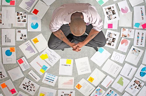 D4K800 Businessman surrounded by papers