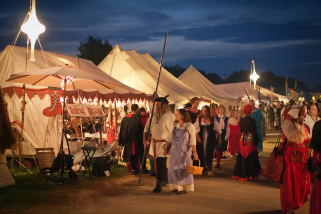Midnight Madness is the night stores open late and music fills the air as people at Pennsic look for deals and friends at the merchant tents glowing in the evening light