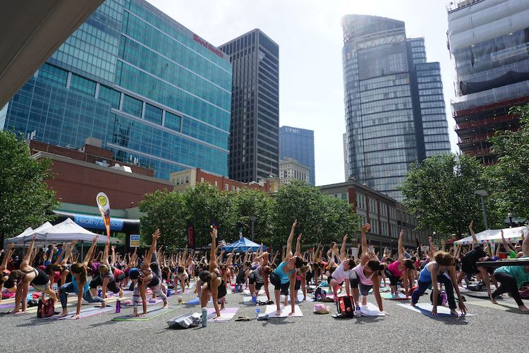 In Market Square, they started the day with yoga, held every Sunday at 10 am.