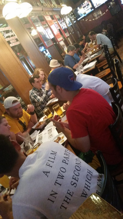 Puzzled Pint participants with brews and brainteasers. Courtesy E Forney.