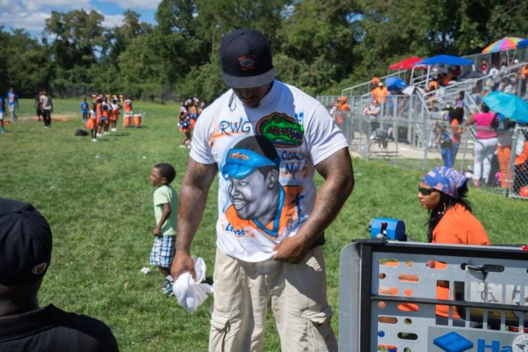 Coach AP wears a shirt honoring Coach Mel. Brian Conway photo.