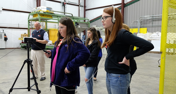 Girls from Mars Area middle school shoot at Adams Manufacturing. Photo by Scott Dietz.