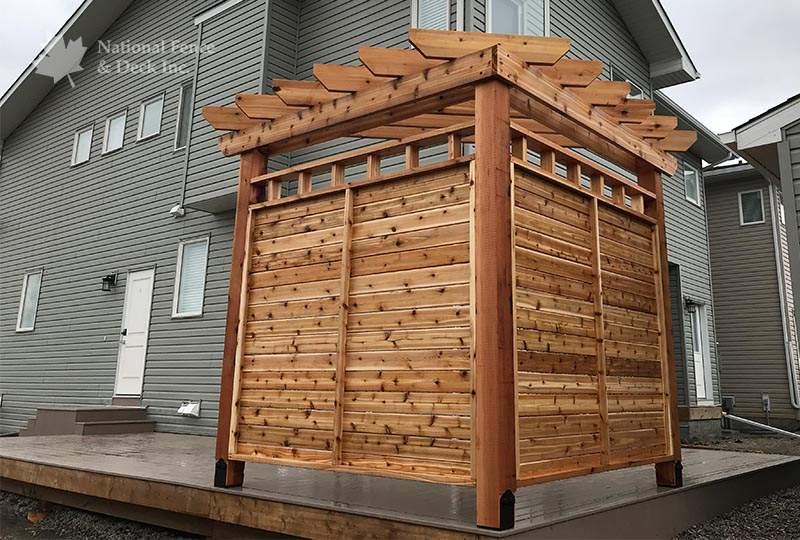 Beautiful cedar pergola in deck corner