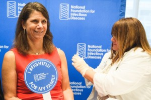 Kathleen M. Neuzil getting vaccinated