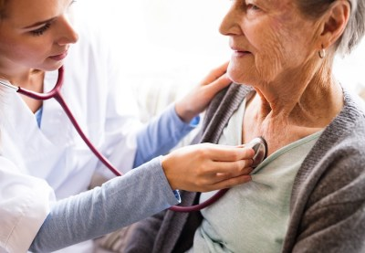 Healthcare professional and older female patient