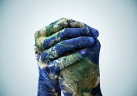 A cropped shot of hands painted to look like the earth