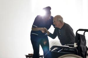Nurse Helping Senior
