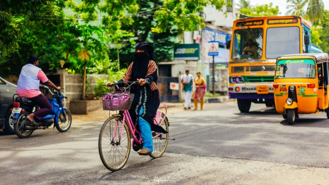 Bicyclist in burka