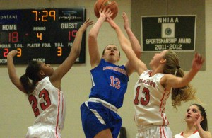 Londonderry's Jaclyn Luckhardt tries to get a shot off as Bedford's Jenoyce Laniyan, left, and Courtney O'Connell defend.