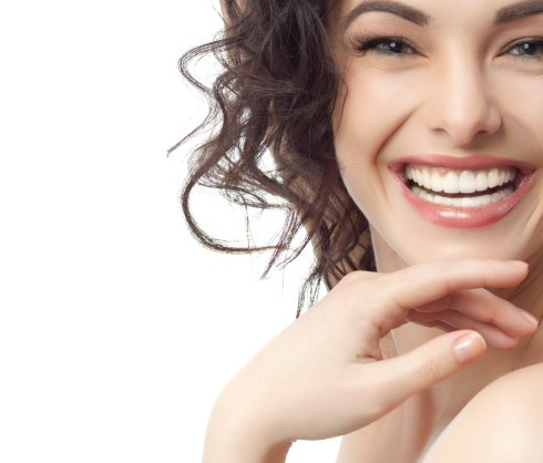 portrait of attractive caucasian smiling woman brunette isolate