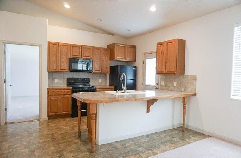 Kitchen in 182 Sun Hawk has granite counters.
