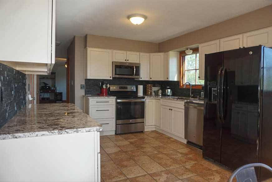 Kitchen was remodeled in 2018 with white cabinets & granite countertops