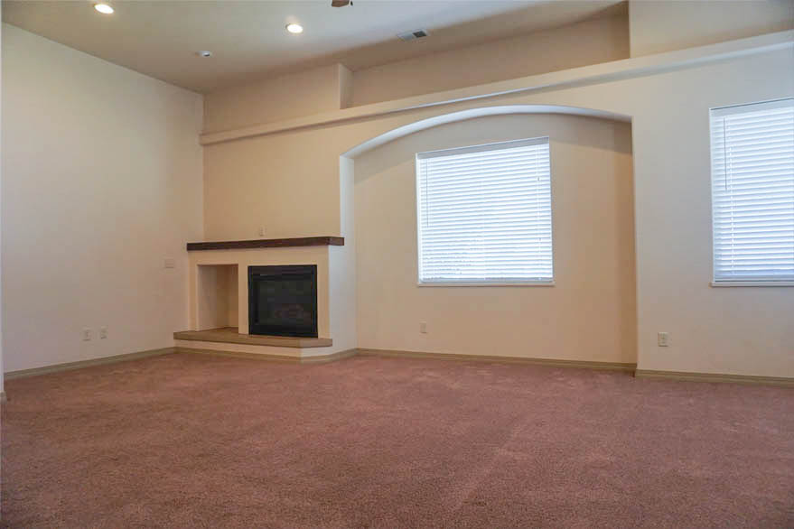 Gas fireplace and vaulted ceilings in the living room of 2997 Black Hawk Way