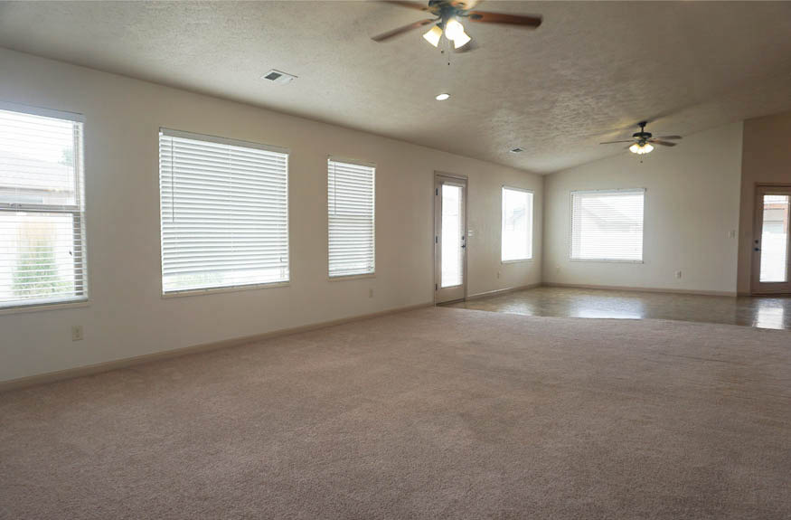 The family & dining rooms have large windows to let in natural light.