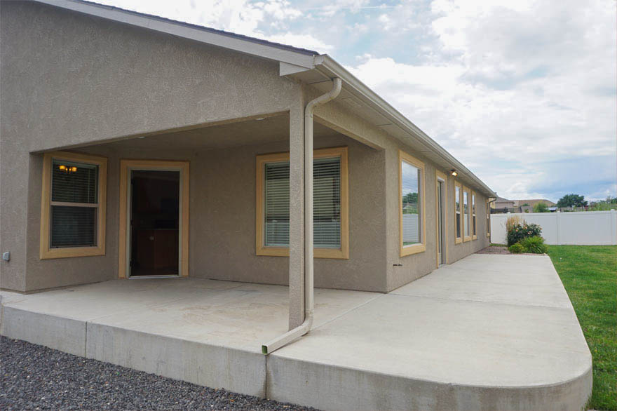The large concrete patio wraps around from the nook & kitchen, and is also accessible from the family room on the back.