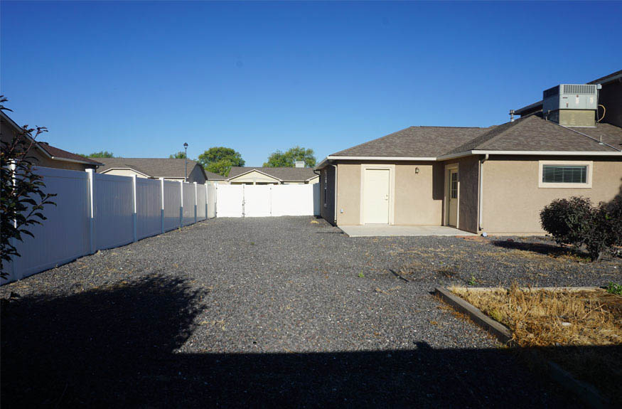 The RV parking area extends the length of the south end of the property, and is accessible from the garage.