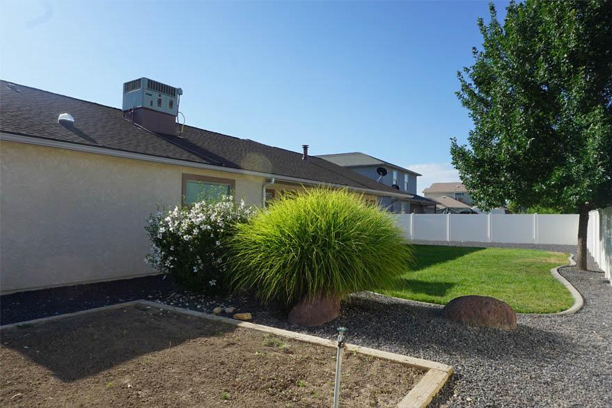 garden area & back yard of 199 Winter Hawk