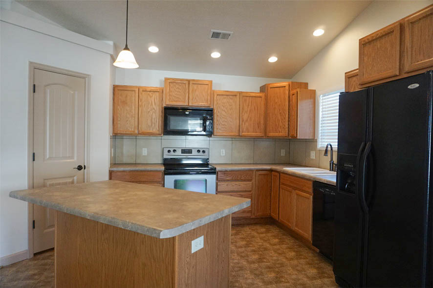 Walk-in pantry, island with a breakfast bar, and all appliances are just some of the features of the kitchen of 199 Winter Hawk Drive.