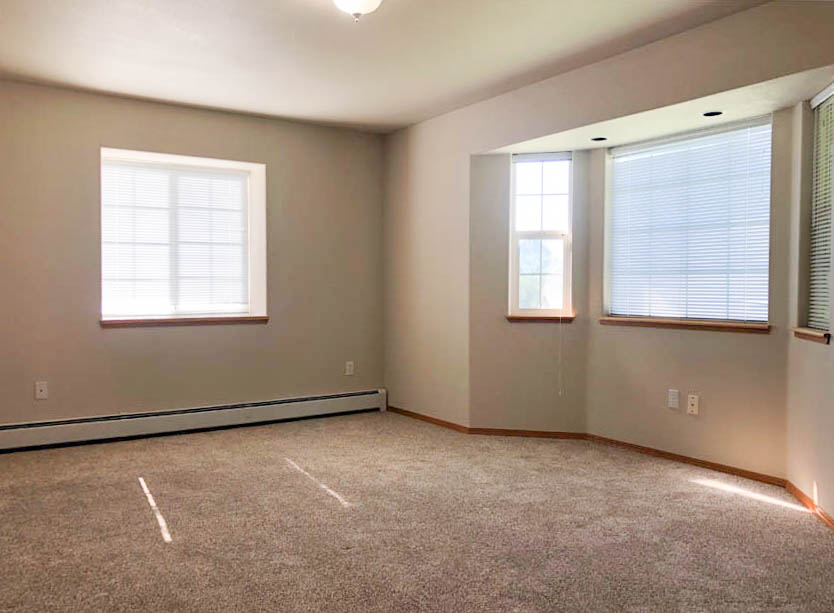 Master bedroom of 653 Fenton has a south-facing bay window, and a box window with an extra deep window sill.