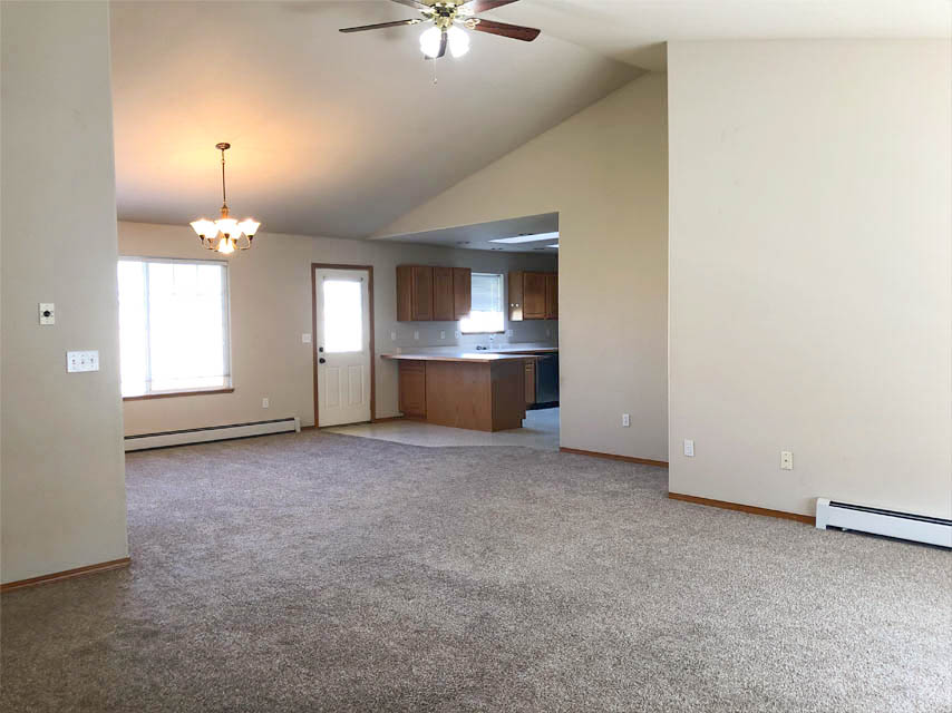 The living area, dining room, and kitchen