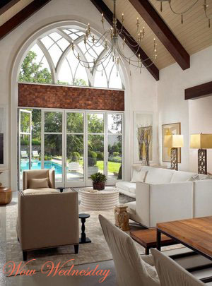 Rustic Luxe living area with a cathedral window overlooking a pool