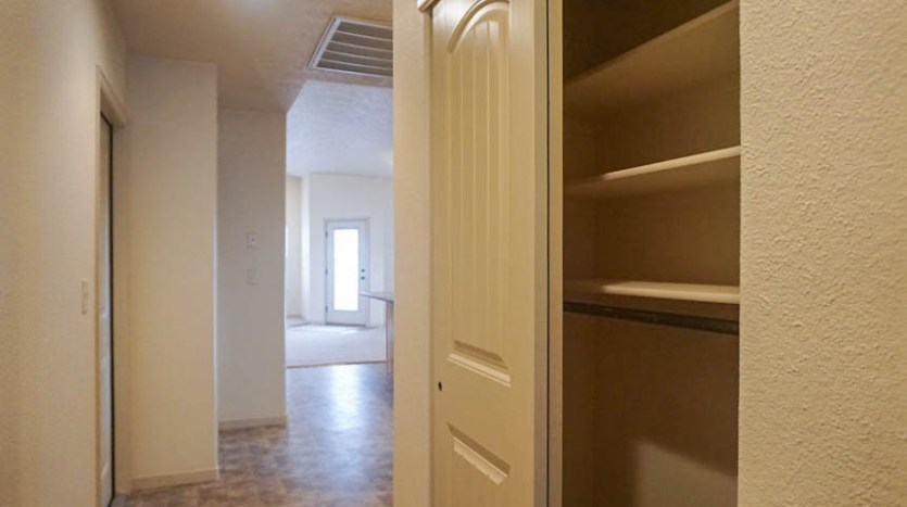 Large linen closet in the hall of 175 Winter Hawk Drive